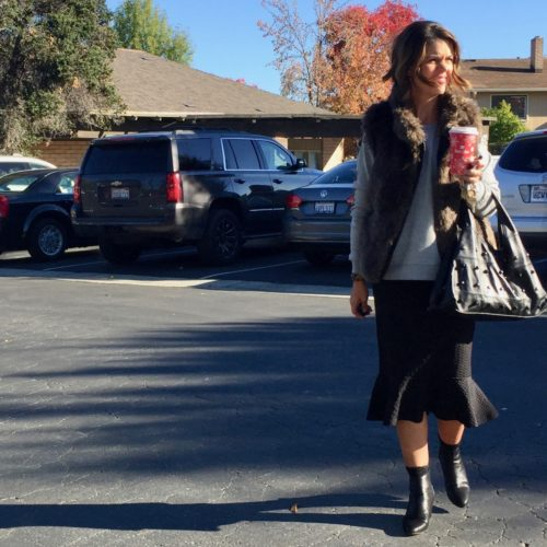 What I Wore: Fall Outfit Ideas featuring a faux fur vest, fluted skirt and embellished sweatshirt   cold shoulder from Anthropologie